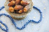 Bowl of dates and rosary