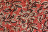 stock photo of gobelin  - Gobelin fabric of red and gold color with a flower ornament - JPG