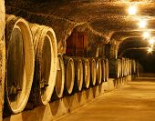 stock photo of fermentation  - Old wine barrels in a wine cellar - JPG