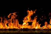 stock photo of infernos  - Fire flames on a black background - JPG