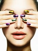 Fashion Beauty. Manicure and Make-up. Nail art. Beautiful Woman With Colorful Nails and Luxury Makeu