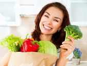 image of vegan  - Happy Young Woman with vegetables in shopping bag  - JPG