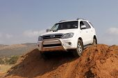 White Toyota Fortuner On 4X4 Course