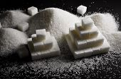 image of substitutes  - Refined white sugar on a black background - JPG