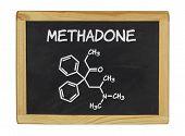 chemical formula of methadone on a blackboard