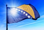 Bosnia and Herzegovina flag waving on the wind