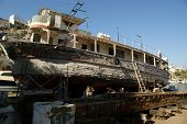old wooden ship in need of restoration in a dry dock