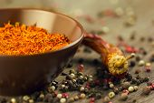 Natural saffron with peppercorns and dried chili
