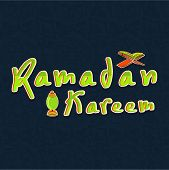 Stylish shiny text Ramadan Kareem with religious Islamic book Quran Shareef and arabic lantern on black background.