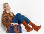 foto of platform shoes  - sitting woman wearing fashionable platform brown shoes with a handbag - JPG