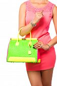 image of mini dress  - Closeup of woman with neon green and pink bag - JPG
