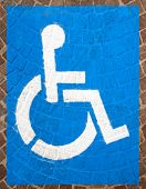 picture of porphyry  - Blue and white road marking for disabled parking on floor with blocks of porphyry - JPG
