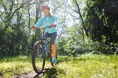 Young Woman On Mountain Bike Fast Ride Outdoors.