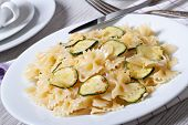 Farfalle Pasta With Zucchini Slices Closeup With A Fork