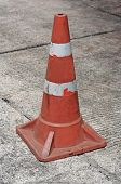 Old Traffic Cone On Bitumen Pavement