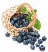 .fresh Blueberries With Leaf In A Basket Is Scattered