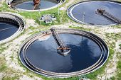 foto of sewage  - Four round full water settlers for sewage recycling