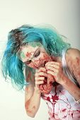A genuine Female Zombie enjoys eating a Fresh Brain from her latest Victim. Zombies are currently th