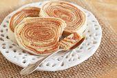 Brazilian Dessert Bolo De Rolo (swiss Roll, Roll Cake) On White Plate Spoon