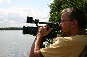 pic of high-def  - Cameraman with professional camera at the Tidal Basin in Washington DC - JPG