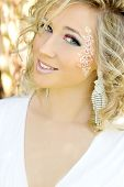 young beautiful elegant, attractive girl blonde with long hair in a Sunny day c a makeup blue eyes