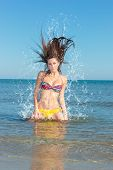 Beauty Model Girl Splashing Water in the ocean. Beautiful Woman in Water