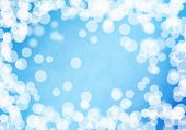 Abstract background image of blue bokeh lights and beams