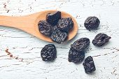 pitted prunes on old table