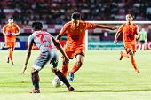Sisaket Thailand-june 29: Eakkapan Nuikhao Of Sisaket Fc. (orange) In Action During Thai Premier Lea