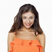 Portrait of sexy woman in orange dress, isolated on white