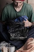 Poor Man With Garbage Bag In Hand