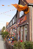 Orange Flags Against Houses In Holland
