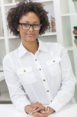 A beautiful intelligent mixed race African American black girl or young woman looking happy and wear