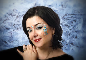 picture of vedic  - Face portrait of Caucasian mature woman with Vedic patterns on frost background - JPG