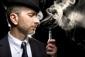 stock photo of tobacco smoke  - male smoking a vapor cigarette as an alternative to tobacco - JPG