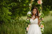 pic of swings  - A beautiful bride in a white wedding dress - JPG