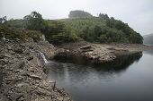 Landscape Image Of Waterfall Flowing Into Abandoned Quarry