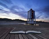 Beautiful Landscape Sunrise Stilt Lighthouse On Beach Conceptual Book Image