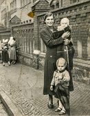 GERMANY, SEPTEMBER 13, 1938: Vintage photo of mother with her children