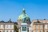 Castle Amalienborg With Statue Of Frederick V  In Copenhagen,