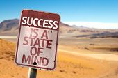 Success Is A State of Mind sign with a desert background