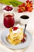 Crepes With Sour Cream and Homemade Strawberry Jam And Coffee selective focus