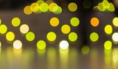 Abstract background of blurred yellow color lights with bokeh effect