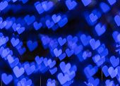 Abstract blue hearts bokeh background
