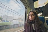 Beautiful Young Brunette Travelling By Train