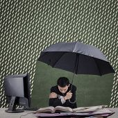 Cold Businessman Working With Umbrella