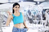 Successful Woman Lose Weight At Fitness Center