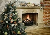 Christmas Tree Next To Marble Fireplace