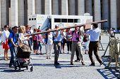 Vatican City Center Life - Pilgrims Carry Cross