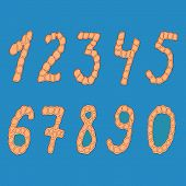 Set of isolated digits of cardboard on a blue background.